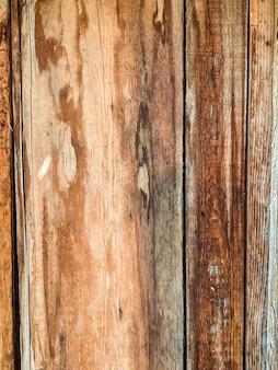 Primer plano sobre viejas tablas de madera dañadas textura del fondo de pared