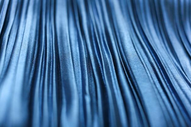 Primer plano de tela azul fruncido