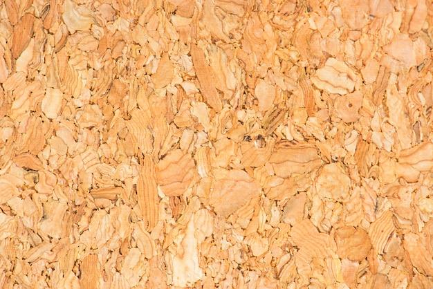 Primer plano de tela de corcho naranja