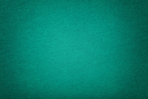 Primer plano de tela de gamuza mate turquesa oscuro. textura de terciopelo de fieltro.