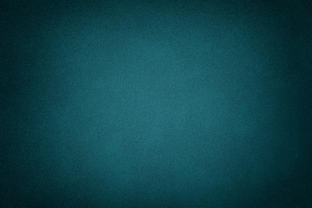 Primer plano de tela de gamuza mate verde oscuro.