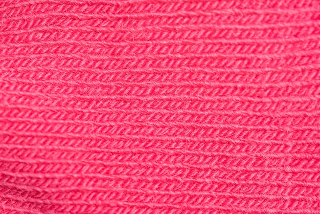 Primer plano de la textura de lana rosa de punto