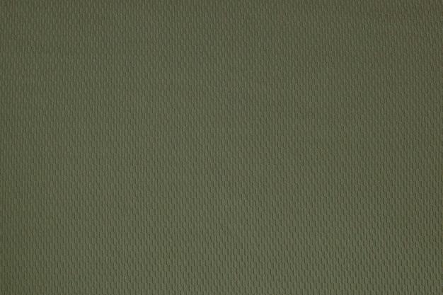 Primer plano de textura de tela de lino áspero verde oscuro como fondo.