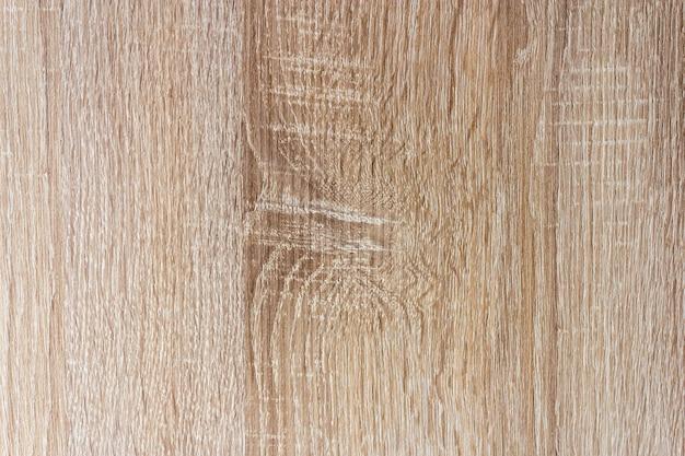 Primer plano de un trozo de madera bajo las luces - agradable para fondos y texturas