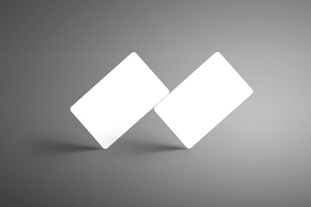 Realista dos tarjetas de regalo de banco blanco de pie en la esquina con fondo aislado de sombras. listo para usar en tu escaparate.