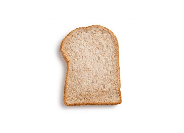 Rebane el pan integral en el fondo blanco