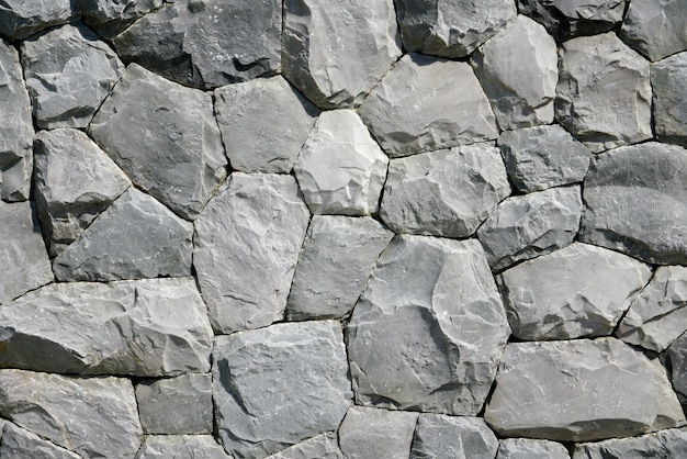 Redondo y pentágono fondo de piedra negra y papel tapiz