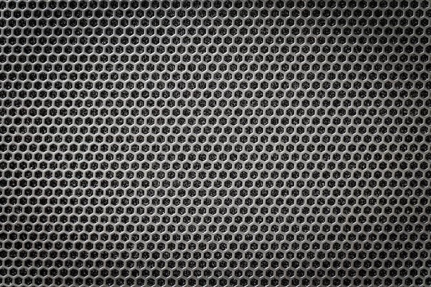 Rejilla de acero negra con agujeros hexagonales