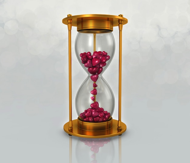 Reloj de arena y corazon rosa.