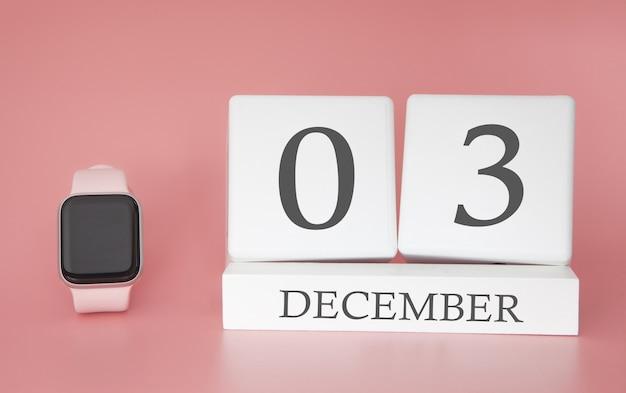 Reloj moderno con calendario de cubo y fecha 03 de diciembre sobre fondo rosa. concepto de vacaciones de invierno.
