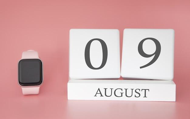 Reloj moderno con calendario de cubo y fecha 09 de agosto en la pared rosa. concepto de vacaciones de verano.