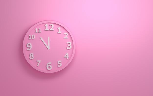 Reloj de pared rosado con los números blancos en el fondo de la pared rosada.