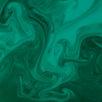 Remolino de color verde acrílico o fondo de textura de giro de mármol similar