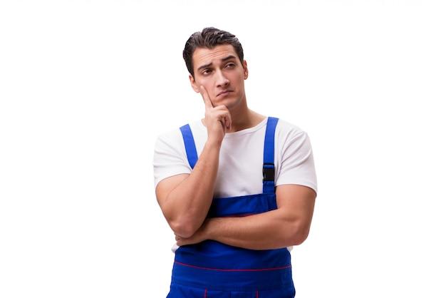 Reparador guapo vistiendo overol azul sobre blanco