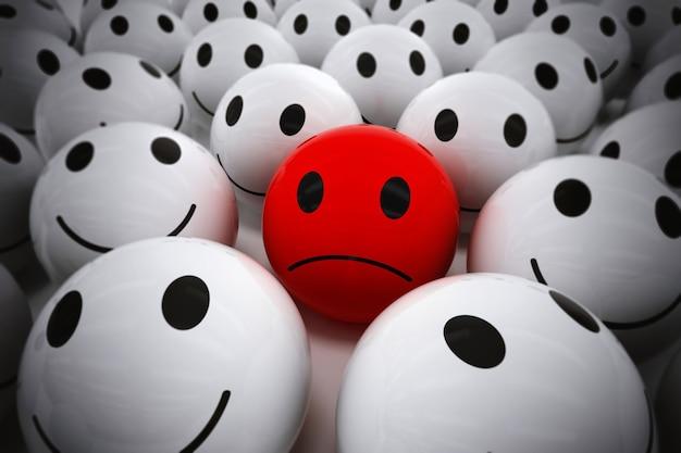Representación 3d de bola roja con cara triste entre tantas bolas blancas sonrientes. equipo feliz apoya a su líder triste