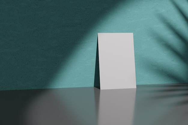 Representación 3d maqueta tarjeta de papel en una pared turquesa interior vacío en la luz del sol.