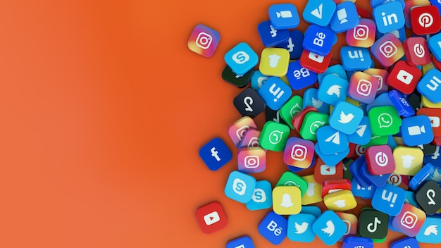 Representación 3d de un montón de logotipos cuadrados de las principales aplicaciones de redes sociales sobre fondo naranja