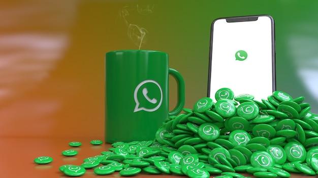 Representación 3d de un teléfono inteligente que emerge de un montón de pils brillantes de whatsapp delante de una taza verde