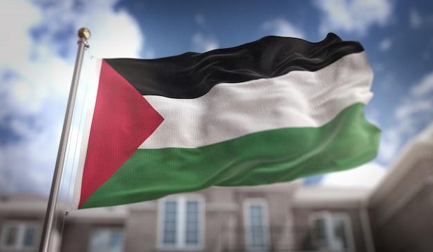 Representación de la bandera de palestina 3d en fondo del edificio del cielo azul
