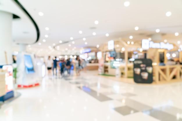 Resumen blur centro comercial o interior de grandes almacenes para el fondo