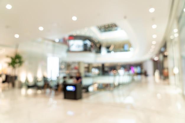 Resumen blur centro comercial y tienda para el fondo