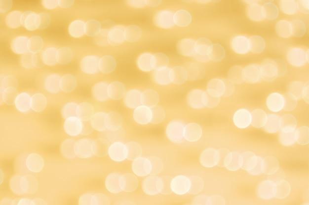 Resumen bokeh de oro circunda el fondo