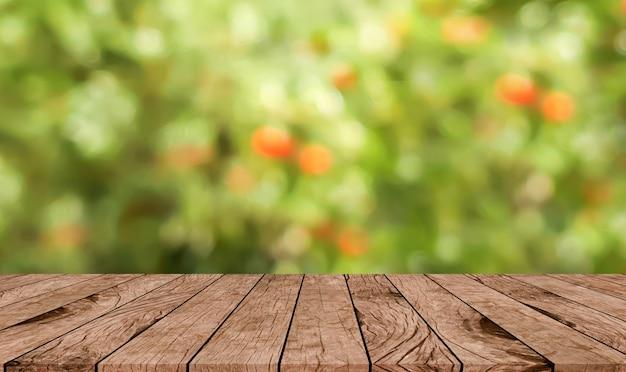 Resumen borrosa jardín de granja de manzana con perspectiva de madera marrón
