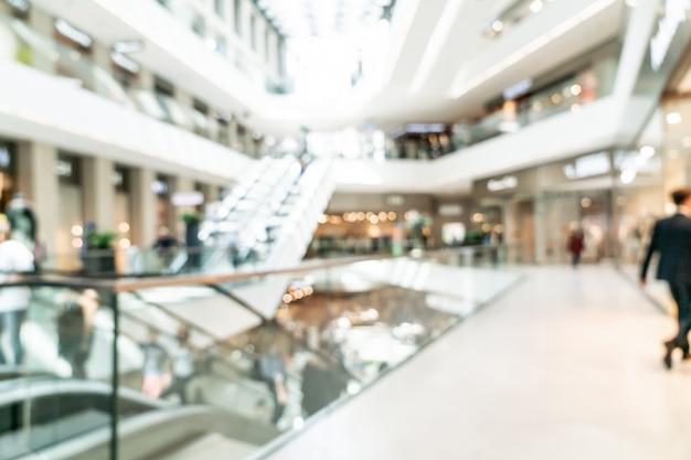 Resumen borroso con bokeh y centro comercial desenfocado en la tienda departamental