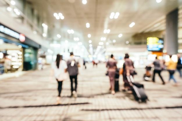 Resumen borroso e interior de terminal de aeropuerto de changi desenfocado