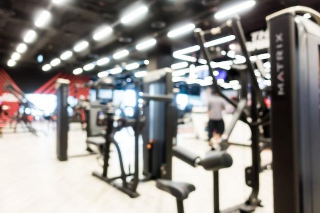 Resumen borroso gimnasio y sala de fitness interior