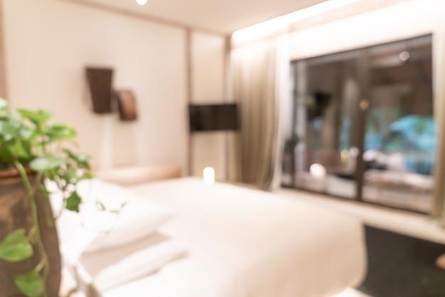 Resumen borroso interior de dormitorio de hotel de lujo resort para el fondo