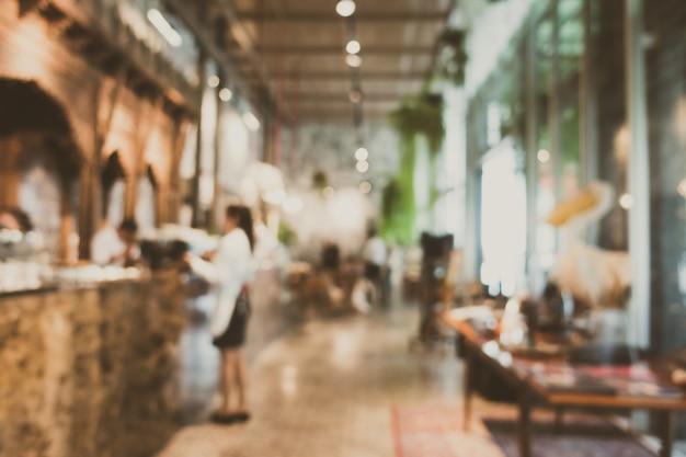 Resumen borroso y restaurante desenfocado