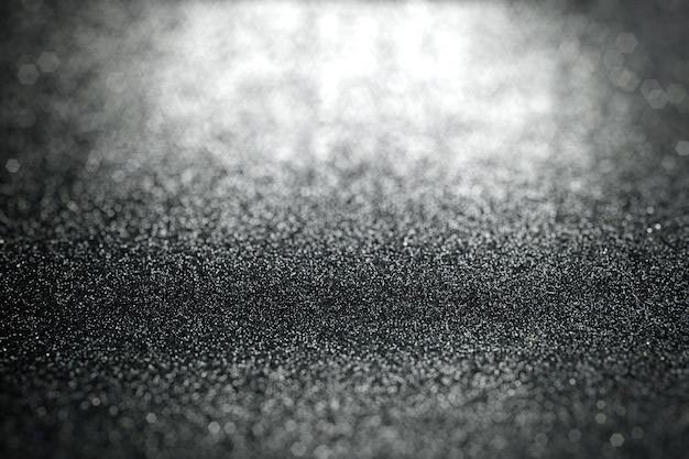 Resumen brillo negro enciende el fondo con textura superficial enfocada