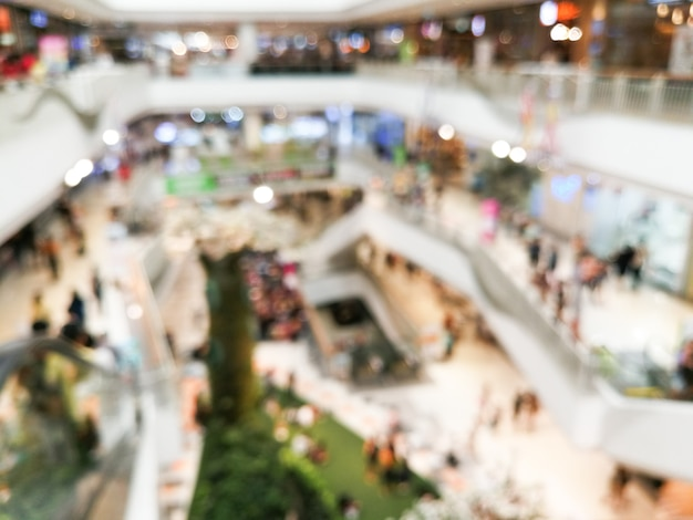 Resumen centro comercial de desenfoque del interior de los grandes almacenes para el fondo. imagen borrosa interior del centro comercial principal hall.