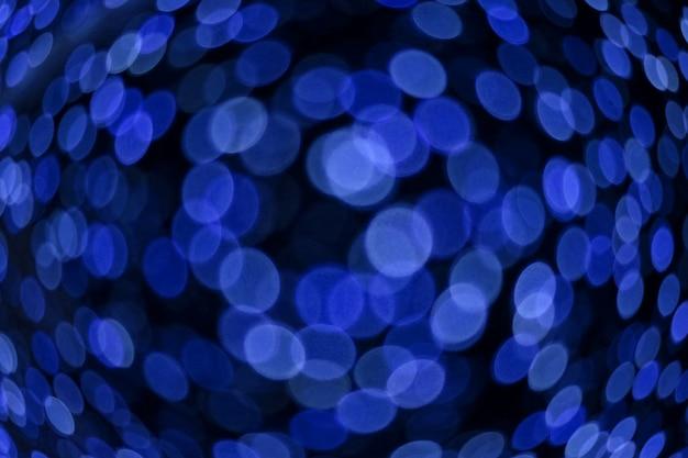 Resumen de color azul oscuro de desenfoque y bokeh luz interior colorido y jardín nocturno