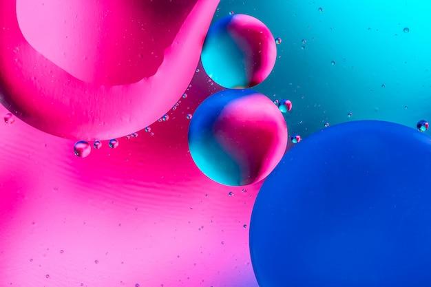 Resumen con colores degradados de colores. las gotas de aceite en el agua resumen imagen patrón psicodélico.