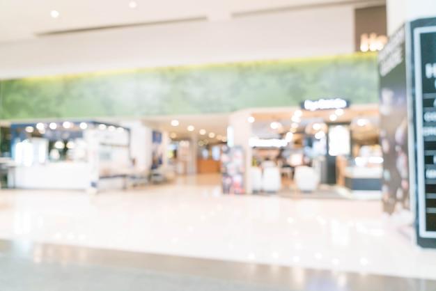 Resumen desenfoque en centro comercial de lujo y tienda minorista