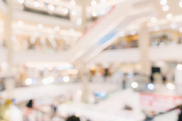 Resumen de desenfoque de fondo multitud de personas en el centro comercial para el fondo, vintage entonado.