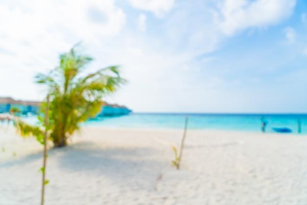 Resumen desenfoque tropical playa y mar en maldivas