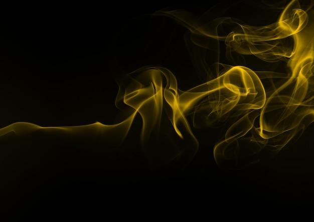 Resumen de humo amarillo sobre fondo negro, diseño de fuego
