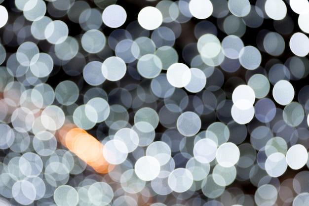 Resumen luz bokeh como fondo desenfocada y borrosa muchos luz redonda