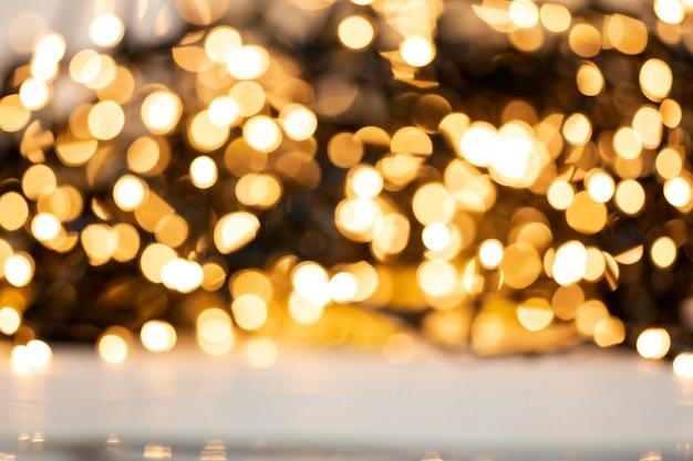 Resumen de luz dorada defocused navidad o textura de fondo de vacaciones, brillante amarillo borroso tonos cálidos coloridos