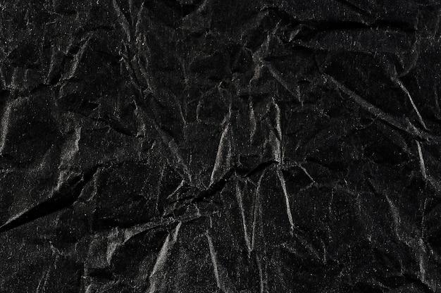 Resumen con papel arrugado negro
