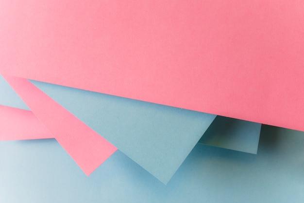 Resumen de papel de color gris y fondo rosa