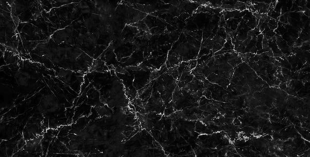 Resumen de patrón de piedra natural de textura de fondo de mármol negro para obras de arte de diseño.