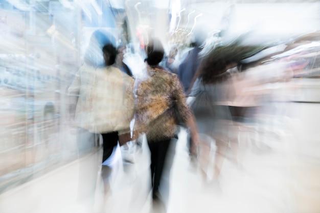 Resumen de personas borrosas en el centro comercial de lujo hermoso centro y tienda tienda minorista