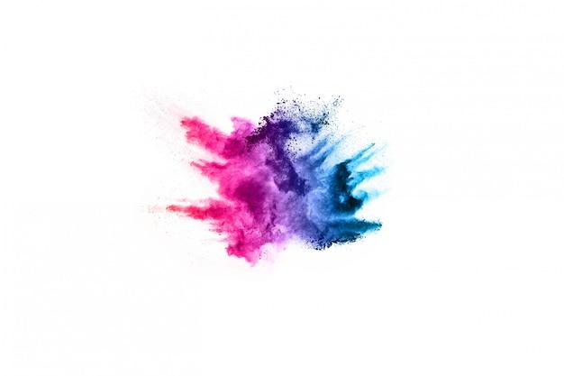 Resumen de polvo salpicado de fondo. explosión colorida del polvo en el fondo blanco.