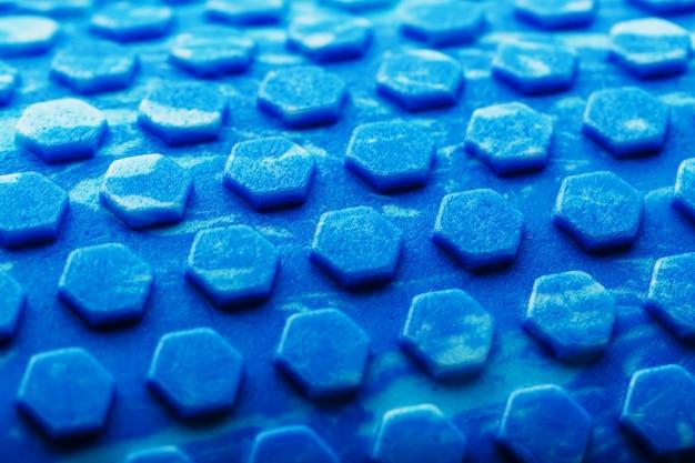 Resumen textura azul con celdas hexagonales la pantalla completa como fondo. textura conceptual en el patrón hexagonal hades.