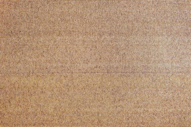 Resumen textura de fondo marrón. superficie de tela de saco rugoso como telón de fondo para el diseño.