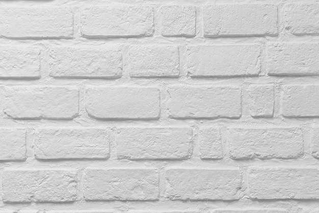 Resumen textura resistida manchada viejo estuco gris claro y pintura envejecida fondo de pared de ladrillo blanco en la habitación rural
